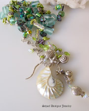 Schaef Designs long necklace of vintage aqua sea glass, lampwork beads, abalone, pearls, dichroic glass, & swarovski crystals hand linked with silver wire and sealife charms nautilus shell | New Mexico