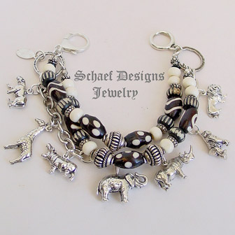 Schaef Designs black & white trade bead & sterling silver endangered species african animals 3 strand white coral charm bracelet | New Mexico