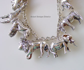 Susan Cummings sterling silver endangered species african animal charm necklace | Upscale online jewelry boutique gallery | Schaef Designs Totem Animal Shaman Jewelry | San Diego, CA