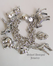 Schaef Designs White Coral & Sterling Silver Endangered African Animal 3 Strand Charm Bracelet | New Mexico