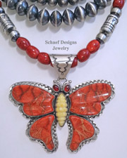David Troutman Apple Coral, Fossilized Mammoth Ivory & garnet Large butterfly Pendant | Schaef Designs| New Mexico